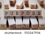 Small photo of Purpose Word In Wooden Cube