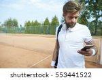 man after finished tennis match   Shutterstock . vector #553441522