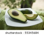ripe chopped avocado on a white plate - stock photo