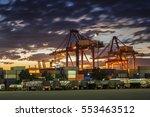 shipping port in sunset | Shutterstock . vector #553463512