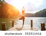 Small photo of Healthy Yoga woman lifestyle balanced practicing meditate and energy yoga on the bridge in morning and sunset the nature. Healthy Concept