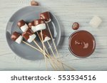 chocolate fondue with... | Shutterstock . vector #553534516
