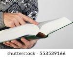 man holds koran   holy book of...   Shutterstock . vector #553539166