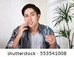 man with toothache | Shutterstock . vector #553541008