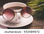 mug  glasses on a wooden table | Shutterstock . vector #553589872
