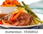 Grilled rib-eye steak with mashed potatoes and asparagus - stock photo