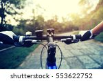 riding mountain bike on forest...   Shutterstock . vector #553622752