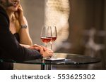 man and a woman having drinks... | Shutterstock . vector #553625302