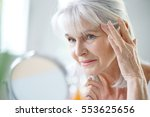 portrait of senior woman... | Shutterstock . vector #553625656