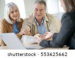 senior couple meeting financial ... | Shutterstock . vector #553625662