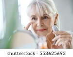 portrait of senior woman... | Shutterstock . vector #553625692