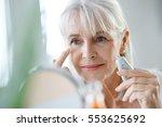 portrait of senior woman... | Shutterstock . vector #553625692