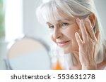 portrait of senior woman... | Shutterstock . vector #553631278