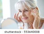 portrait of senior woman... | Shutterstock . vector #553640008