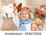 happy kid boy plays with wooden ... | Shutterstock . vector #553675006