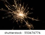 sparkler on black | Shutterstock . vector #553676776