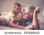 grandpa and granddaughter... | Shutterstock . vector #553688632