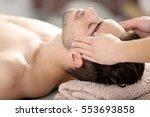 man having face massage in spa... | Shutterstock . vector #553693858