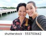 selfie senior woman with... | Shutterstock . vector #553703662