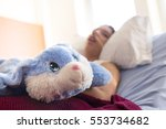 a sick patient lying on bed in... | Shutterstock . vector #553734682