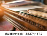 book on old wooden table. desk... | Shutterstock . vector #553744642