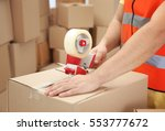 closeup of man packing parcels... | Shutterstock . vector #553777672