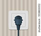 electric plug and socket on a... | Shutterstock .eps vector #553803352