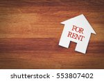 Small photo of house for rent symbol with wood background