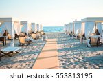 wooden sunbeds in front of a... | Shutterstock . vector #553813195