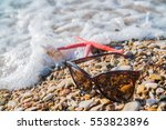 starfish and sunglasses on the... | Shutterstock . vector #553823896