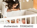 mother putting baby to sleep at ...   Shutterstock . vector #553826032