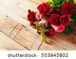 Stock photo valentines day background beautiful bouquet of roses on wooden table 553845802