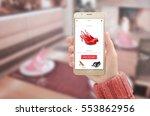 woman showing modern gold smart ... | Shutterstock . vector #553862956