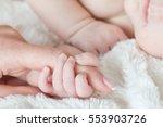 hand the sleeping baby in the... | Shutterstock . vector #553903726