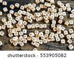 Wooden Dice In Disarray And...
