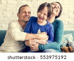 family together cuddling love... | Shutterstock . vector #553975192