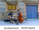 Two Men Are Playing Music In...