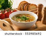 Vegetable Soup With Bread On...