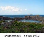 a rocky island above the sea | Shutterstock . vector #554011912