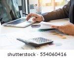 businessman working laptop... | Shutterstock . vector #554060416