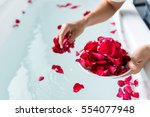 Stock photo rose petals put in bathtub for romantic bathroom in honeymoon suit arranged by interior designer 554077948