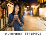 Woman Using Mobile Phone In...