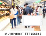 man use mobile phone  blur... | Shutterstock . vector #554166868