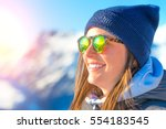 female skier with skis smiling... | Shutterstock . vector #554183545