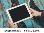 man holding digital tablet with ... | Shutterstock . vector #554191396