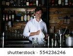 bartender making cocktail at... | Shutterstock . vector #554236246