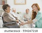 nurse taking care of senior... | Shutterstock . vector #554267218