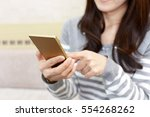 woman with a smart phone   Shutterstock . vector #554268262