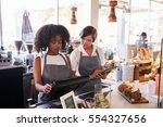 new employee receives training... | Shutterstock . vector #554327656