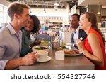 group enjoying business lunch... | Shutterstock . vector #554327746